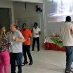 Brasileiros e haitianos dançam juntos no ritmo do país caribenho, no Seminário Regional das Pastorais Sociais, que tratou sobre migrações. (Foto: Marcelo Luiz Zapelini/Agência Sul 4)
